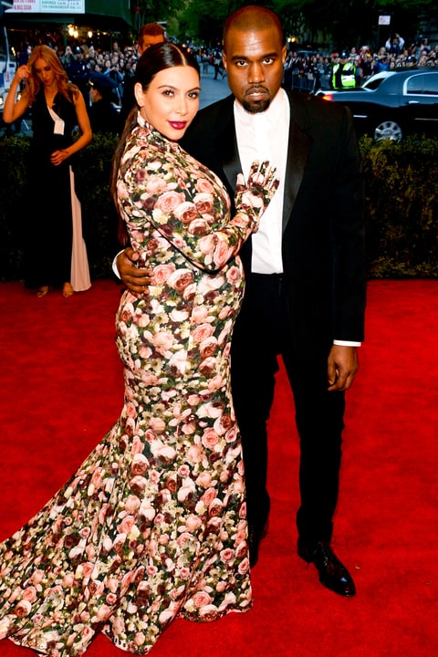 Kim Kardashian and Kanye West at the Oscars on the red carpet