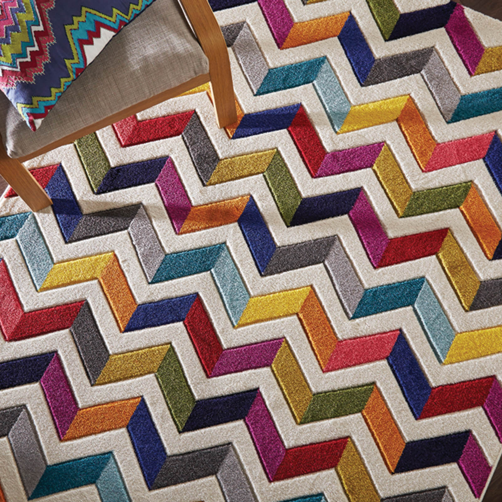 Spectrum zigzag and multicoloured rug part of a joint competition