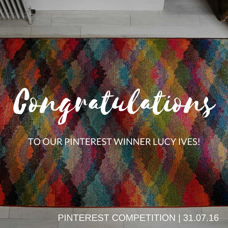 Multicoloured Kaleidoscope rug on a grey wooden floor for Pinterest Competition