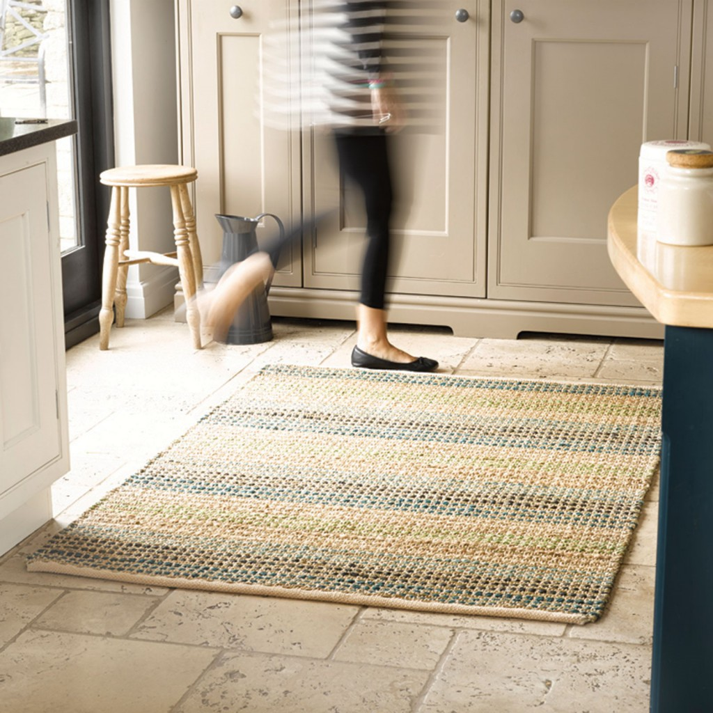 Eco-friendly rug with neutral tones sits on a slate floor in a country kitchen