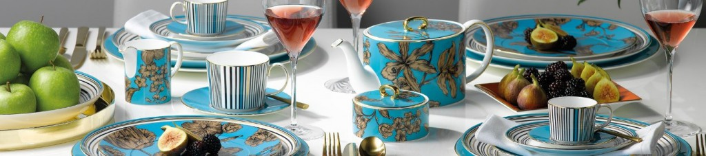 wedgwood vibrance tea set on a table with a white tablecloth amongst wine and food