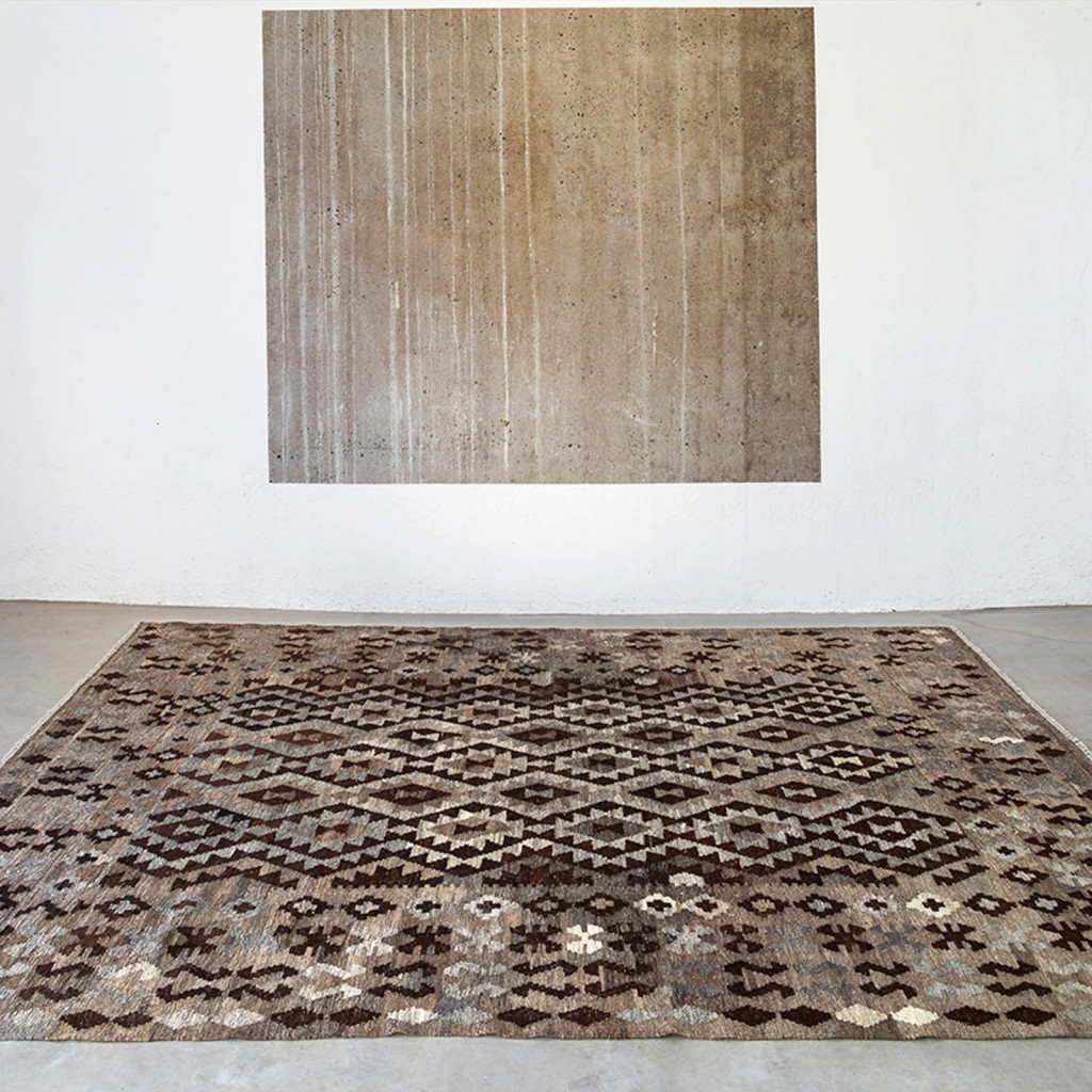 Exotic and ethnic looking Massimo kelim rug, with brown and black patterns
