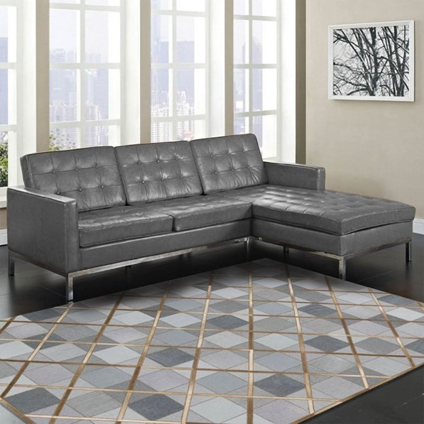 copper interiors cowhide rug with copper strips over denim in a plainly decorated room with a dark grey sofa