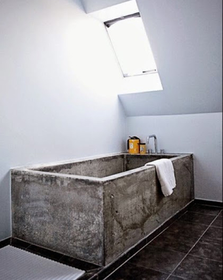 plain bathroom with a concrete bath tub