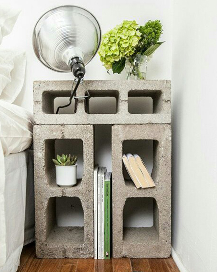 concrete breezeblock bed side table in a white bedroom
