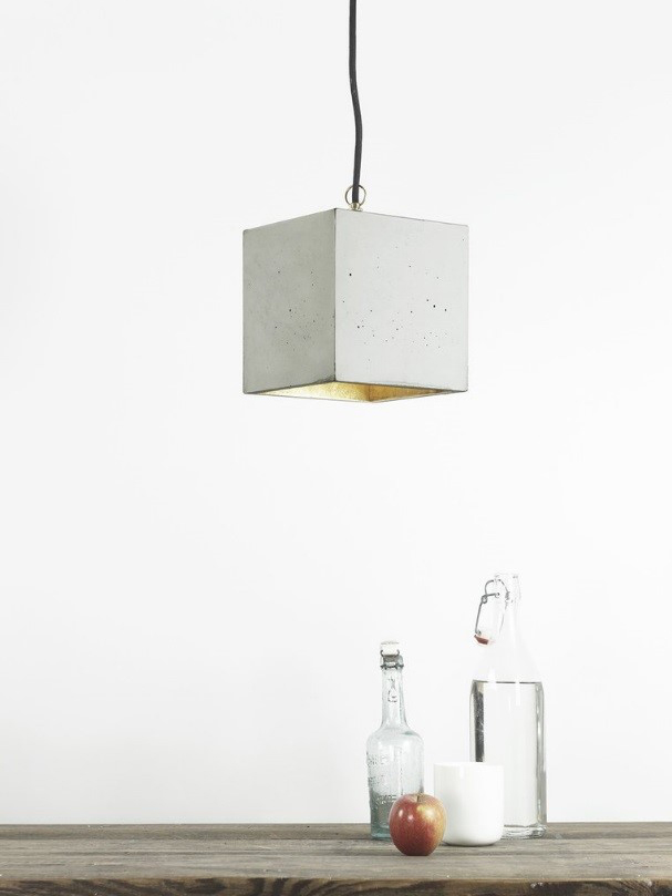plain white wall with a concrete lamp hanging from the ceiling
