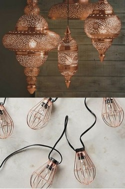 decorative copper lighting for a bedroom with fairy-lights and Moroccan style lampshades for copper interiors