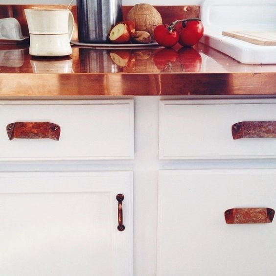 copper worktop and handles with white cupboards for copper interiors