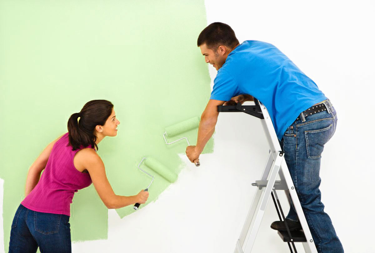 how to paint a room man and woman painting a white room green