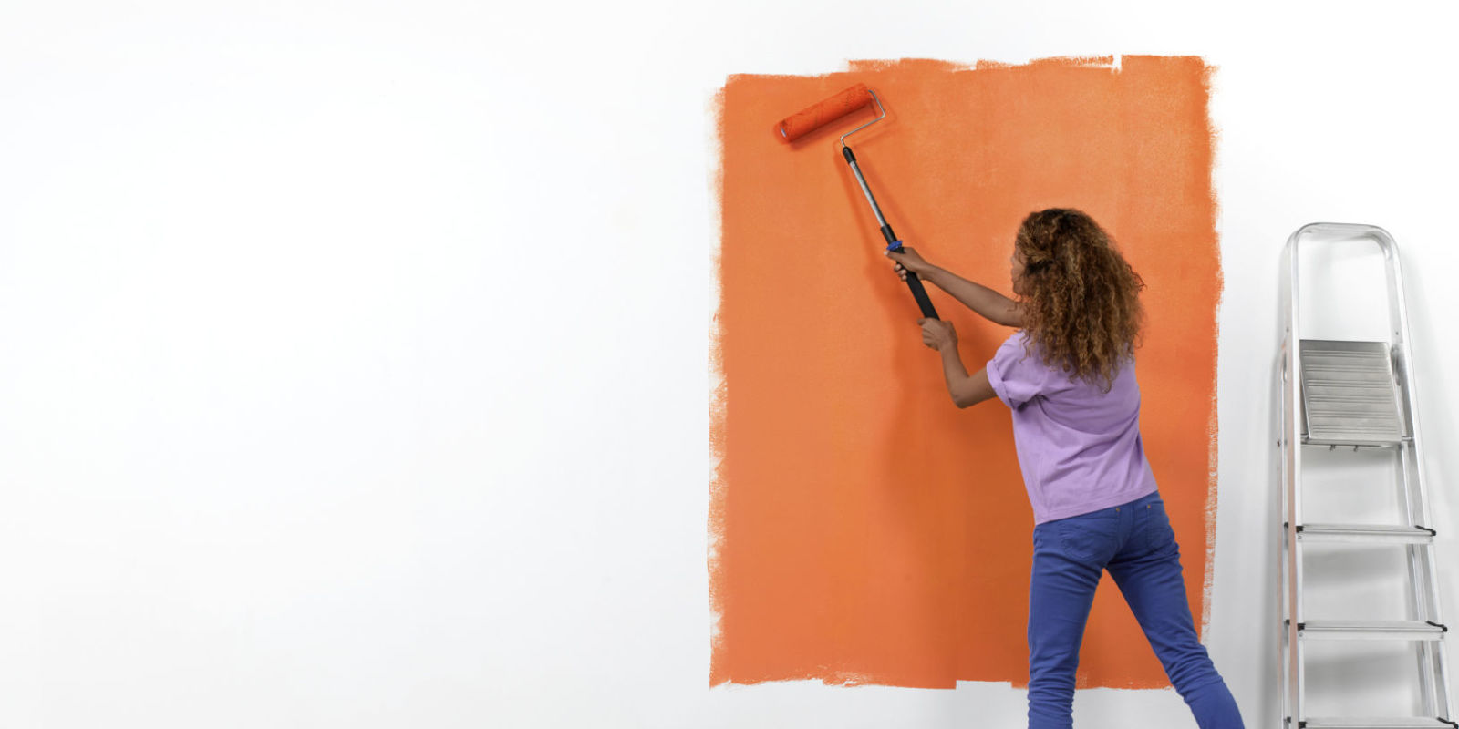 How To Paint A Wall Using A With Roller Technique With A Woman  Demonstrating With Orange