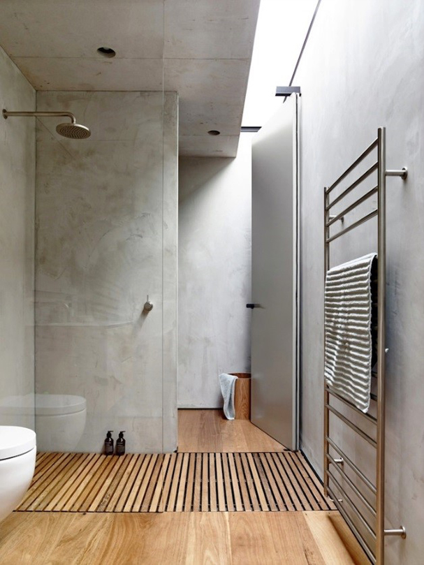 stylish bathroom with a wooden floor and concrete walls