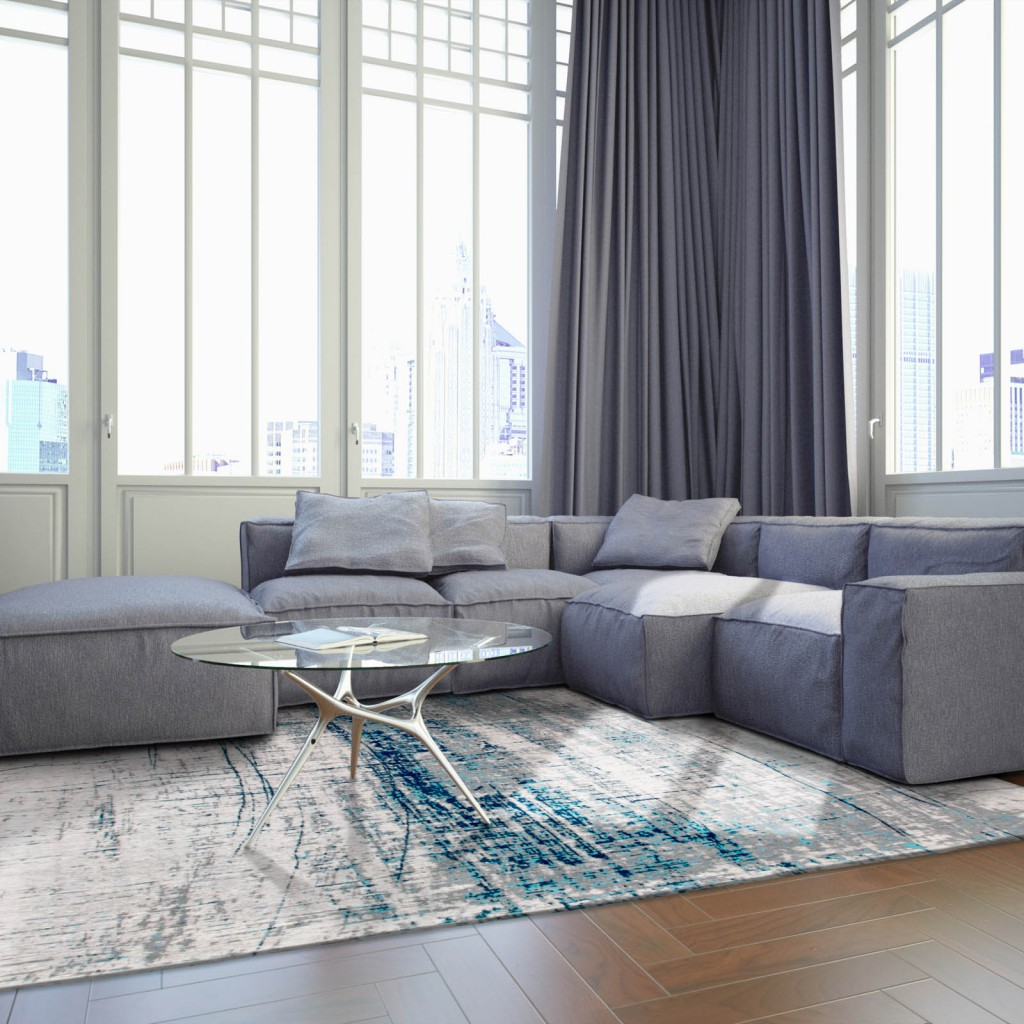 rug care guide - rug in a open living room with sunlight shining through the windows