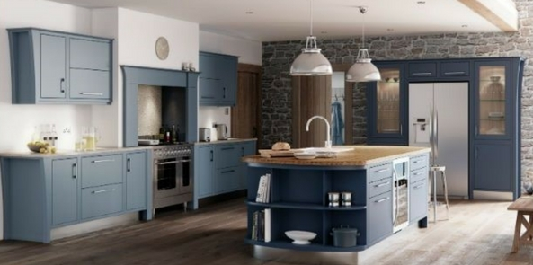 colour trend for 2017 denim blue kitchen with brick walls and grey wooden floors and a white ceiling