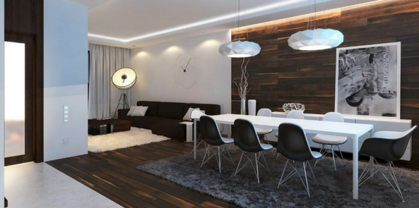 minimalist style faux fur with a grey fur rug under an angular and monochrome table and chair set on dark wooden floor and walls