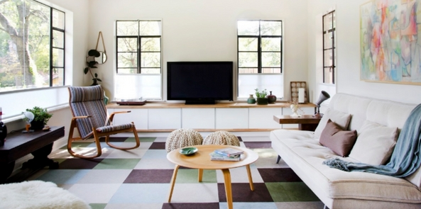 living room rug as large grid coloured rug in a brihgt white room with