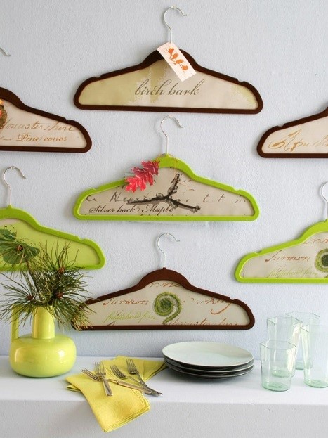 Upcycle clothes hangers filled with wallpaper