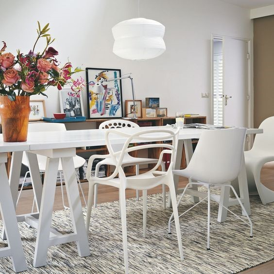 hipster interior design dining room with white table and chairs with a grey rug beneath