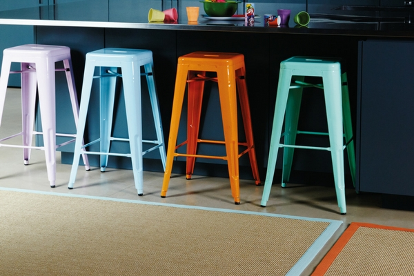 best kitchen rugs sisal rug with bright borders in front of multi-coloured bar stools in front of kitchen surface