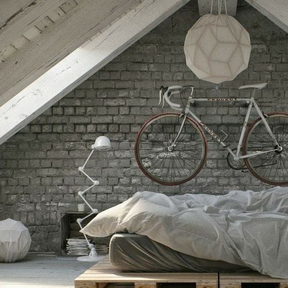 Concrete Hipster Home Decor With Bicycle Feature On The Wall In A Bedroom