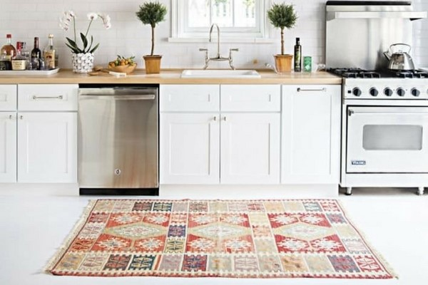 Elegant Best Kitchen Rugs In A White Kitchen With Wooden Worksurfaces And Vintage  Patchwork Orange Rug