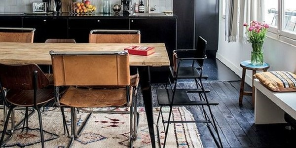 a rustic kitchen with best kitchen rugs traditional rug under the wooden table in front of a dark coloured kitchen