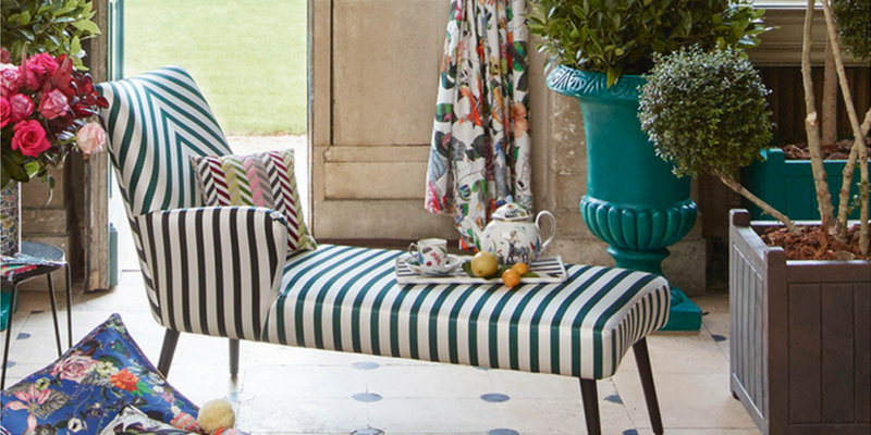 stripes trend armchair in a botanical room