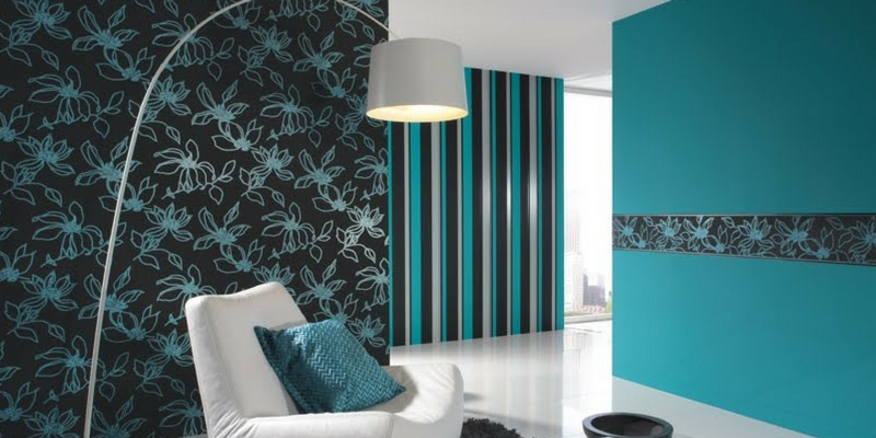 stripes trend a teal coloured living room with patterned and striped walls
