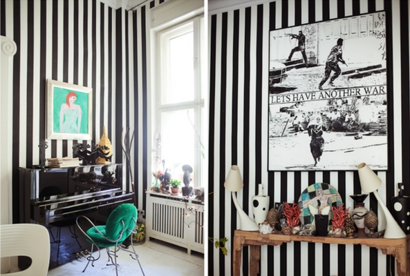 a small space with black and white striped walls to make it seem bigger