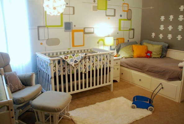layering rugs in a nursery with bold designs and a white cot and bed