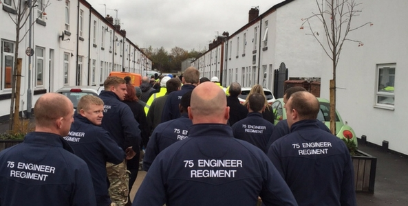 DIY SOS builders and army veterans walking towards the canada street home before reveal