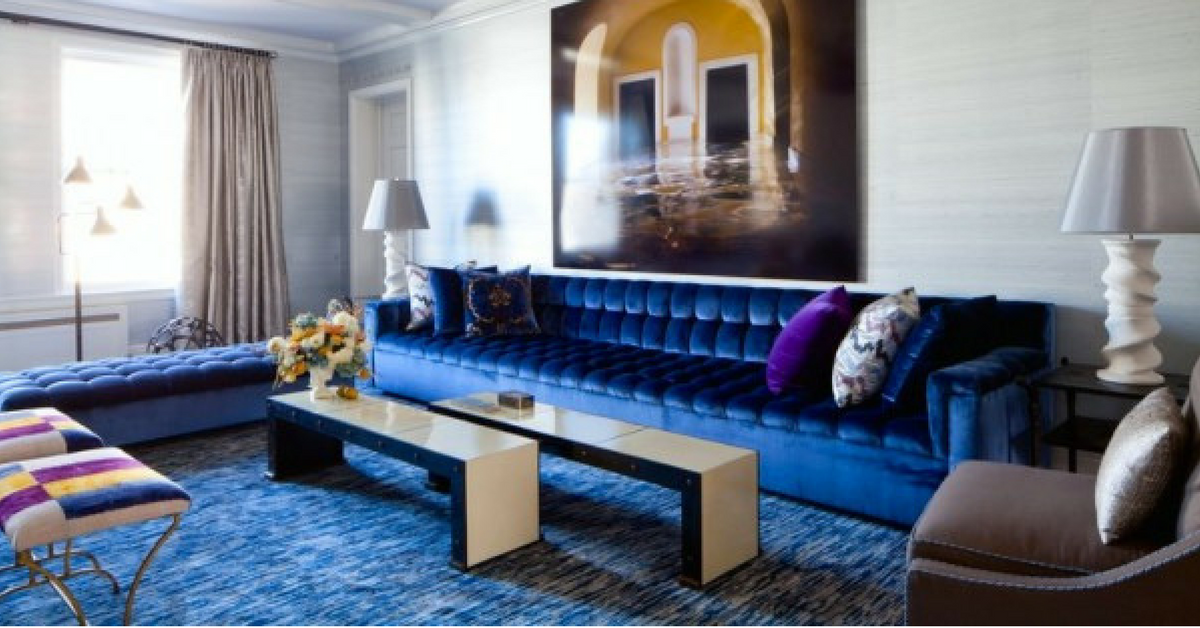 interior design trends, a large living room with jewel tone blue accents