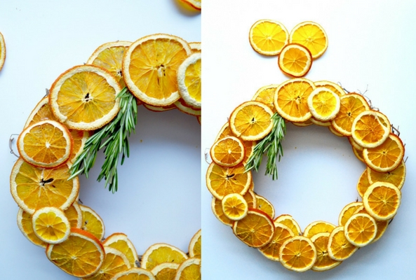 dried orange and rosemary wreath on a pale blue background to help a room smell like christmas