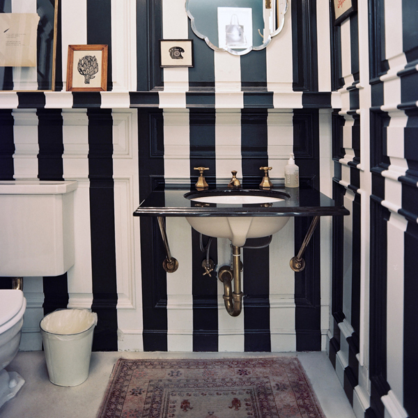 modern bathroom with black and white striped walls
