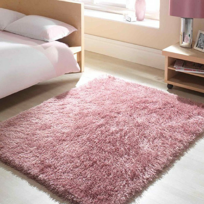 blush pink shaggy rug in a plain style bedroom