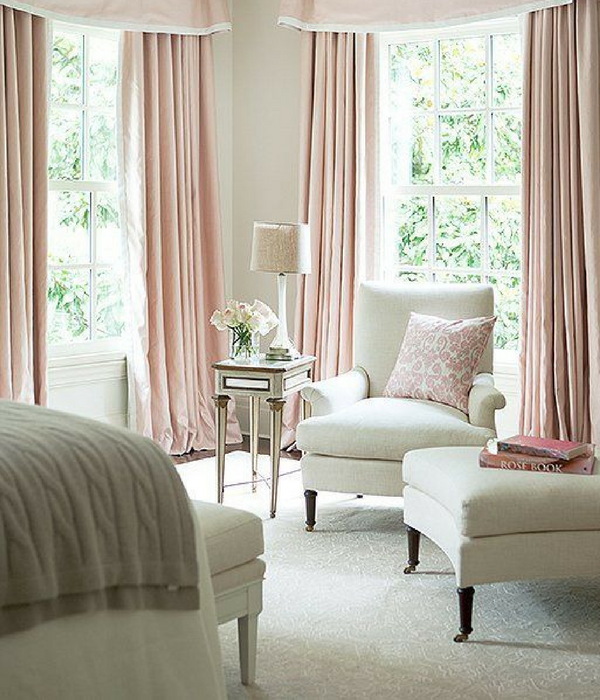 blush pink living room with long drapes curtains