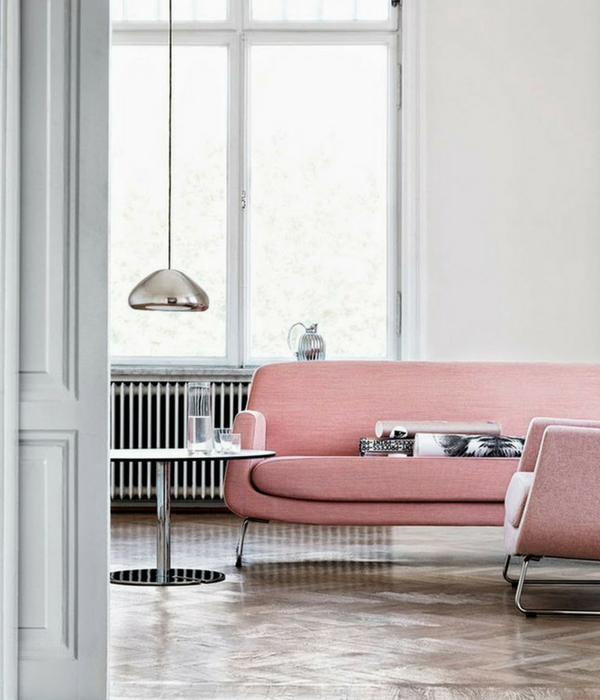 blush pink living room with a pink sofa