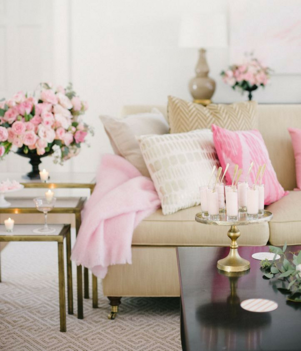 blush pink living room with floral accents placed around the room