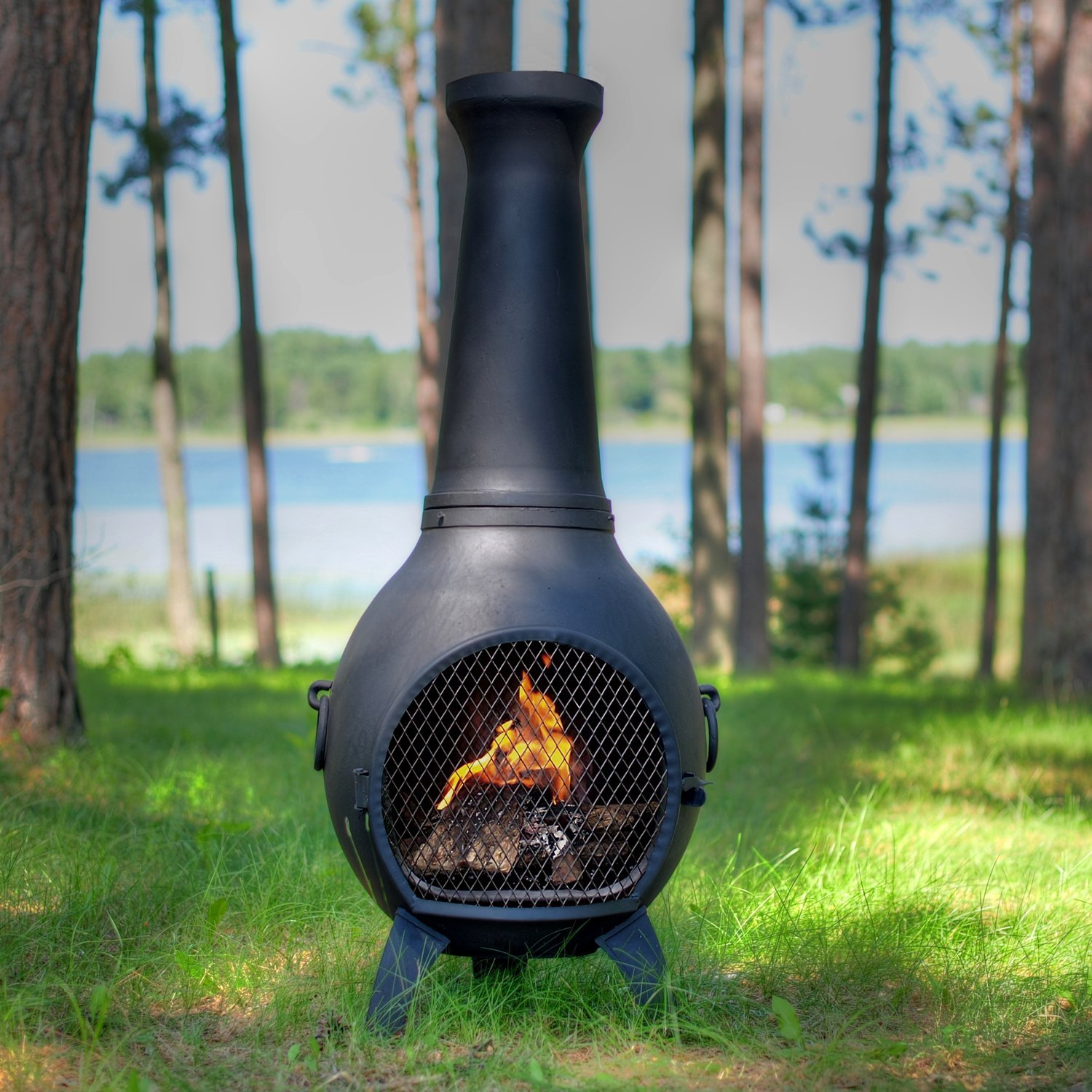 industrial style chiminea in a green garden on grass