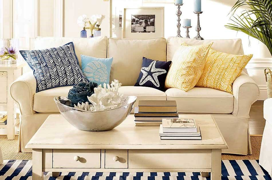a beach or nautical inspired summer living room with patterned cushions