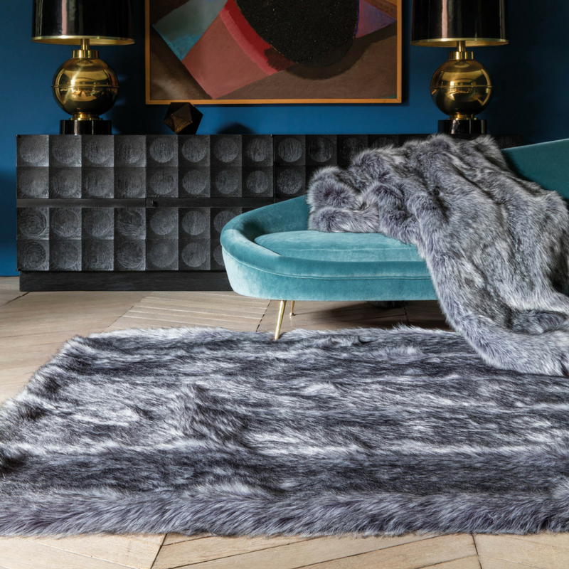 games of thrones style liviing room with faux fur rugs and throws from the rug seller
