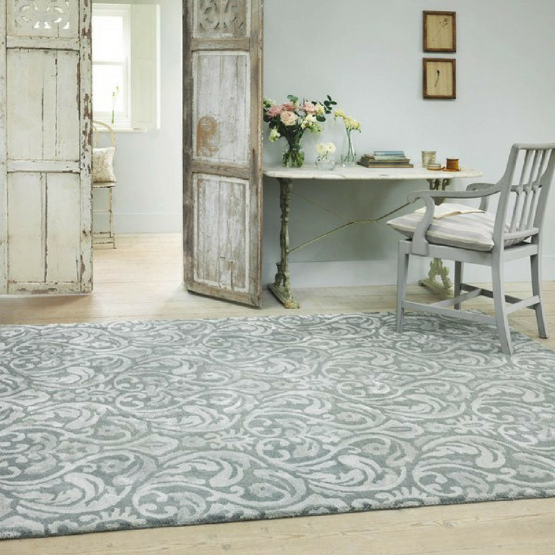 grey and white rug from the rug seller in a vintage looking game of thrones room