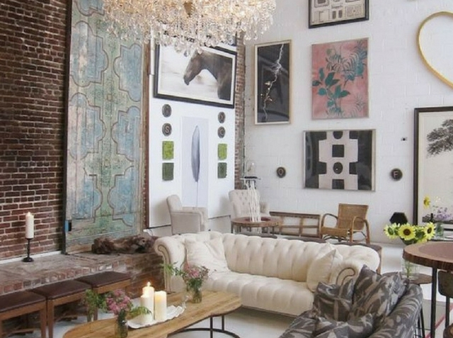 loft inspired living room with a large wall art collection