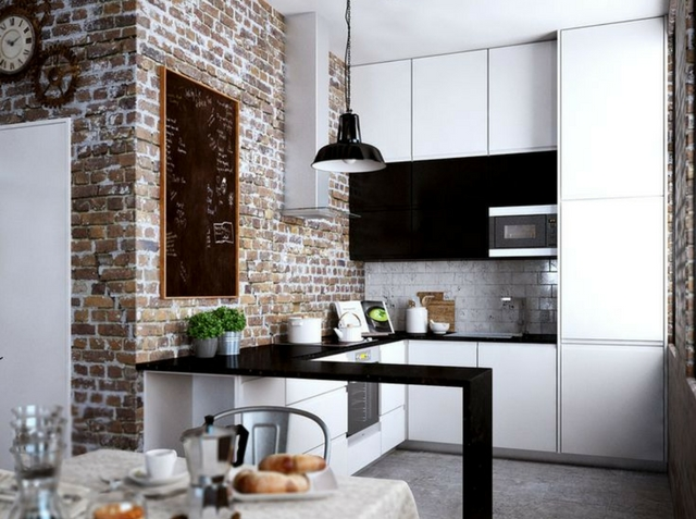 a loft interior with an exposed brick kitchen and dining room