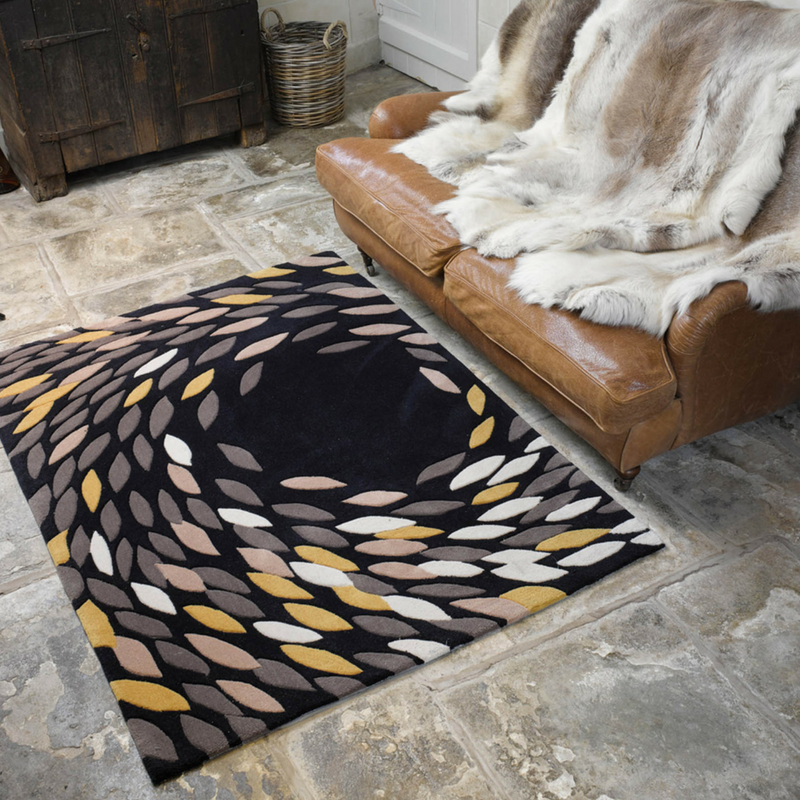 games of thrones style black and gold living room with a faux fur throw
