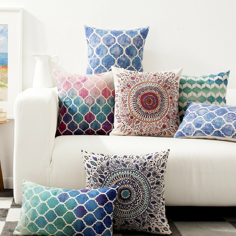 summer vibes geometric pillows and cushions on a white sofa