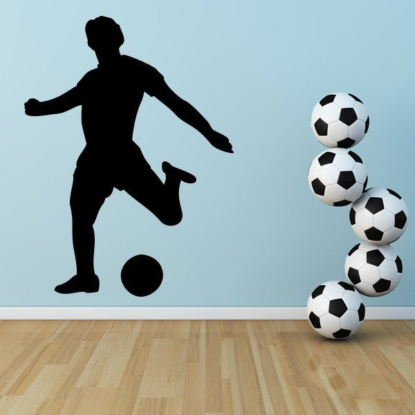 footballer kicking a football wall sticker