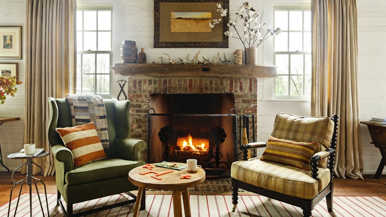 autumn cosy interior with a fireplace and sofas