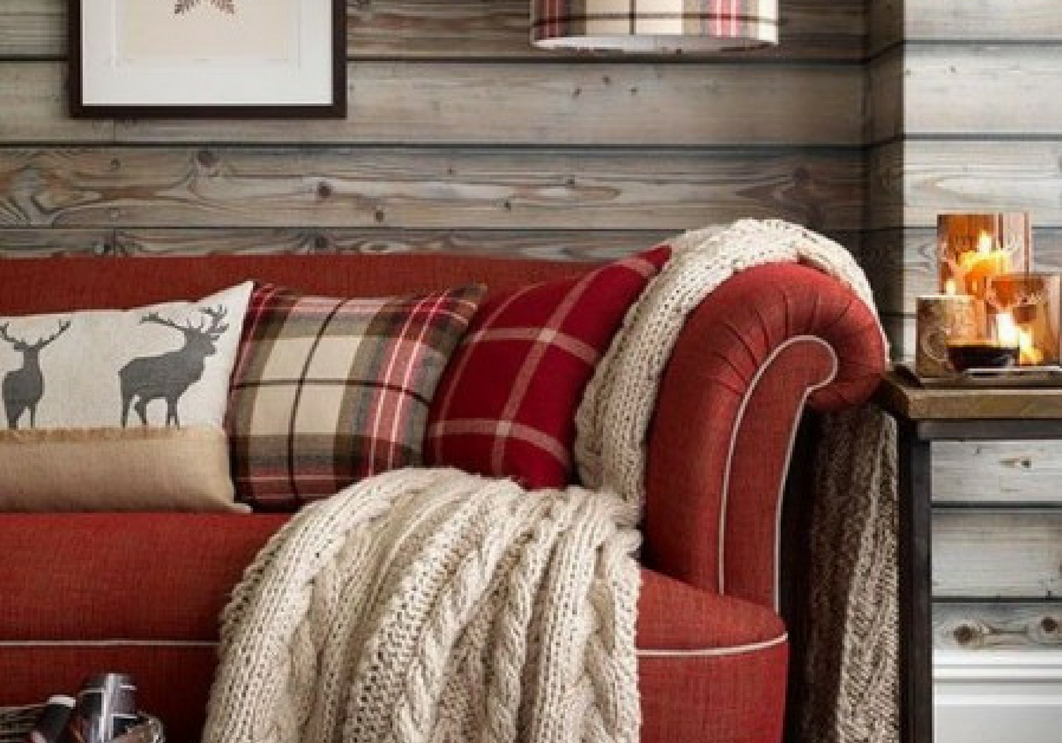 red living room couch with tartan plaid cushions