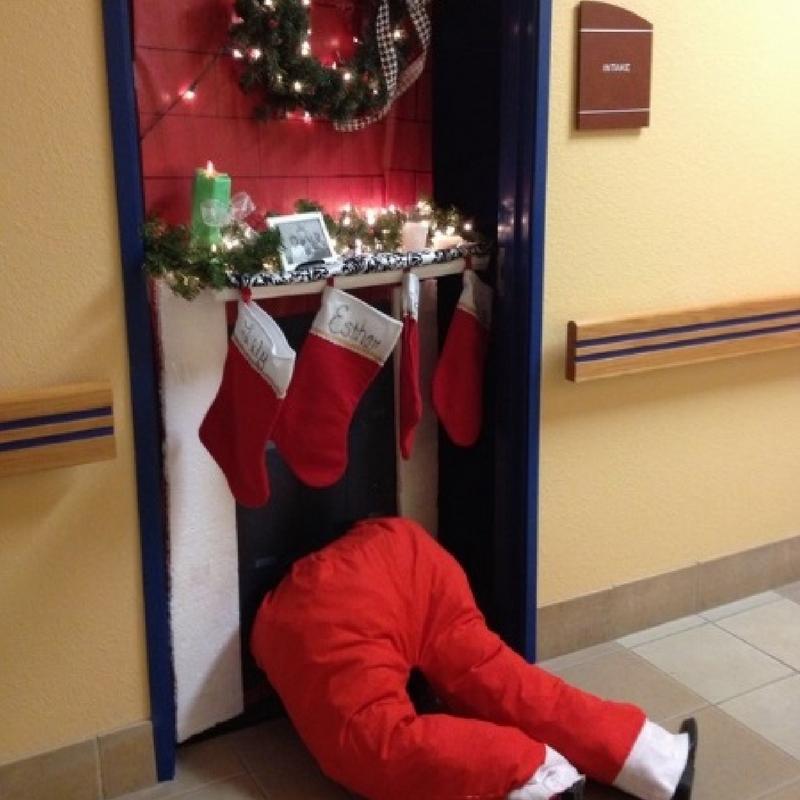 3D santa stuck in a chimney fireplace christmas door decoration