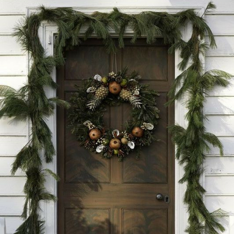 Christmas Door Wreath Decoration on a brown door with a garland